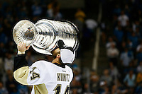 Chris Kunitz #14 of the Pittsburgh Penguins kisses the Stanley Cup following their 3-1 win against the San Jose Sharks during game six of the Stanley Cup Final at SAP Center in San Jose, California on June 12, 2016. (Photo by Jared Wickerham / DKPS)