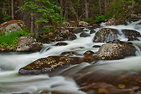 Glacial Creek roars down the mountain side in summer in Rocky Mountain National Park in Colorado