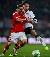 VIENNA, Austria - November 19, 2013: Mix Diskerud and Austria's Christoph Leitgeb during a 0-1 loss to host Austria during the international friendly match between Austria and the USA at Ernst-Happel-Stadium.