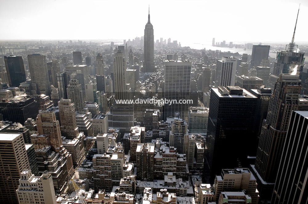13 February 2006 - New York City, NY - View of the Empire State Building and snow covered midtown Manhattan from the Rockefeller Center's Observation Deck, 13 February 2006, New York City, USA, one day after the city suffered the heaviest single day snow fall ever recorded.
