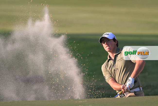 Rory McIlroy (NIR) chips out of a bunker into the hole on the 18th green to win the 2011 UBS Hong Kong Open....Photo www.golffile.ie