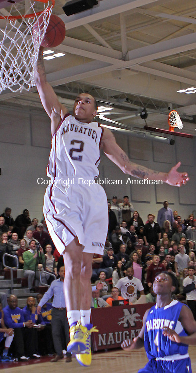 Naugatuck, CT-031015MK11  Naugatuck's Jarron Chapman (#2) slam dunks as Warren Harding's Okoe Narh looks on Tuesday night during opening play of the Class L tournament at Naugatuck High School.  Naugy defeated Harding 60-59. Michael Kabelka / Republican-American