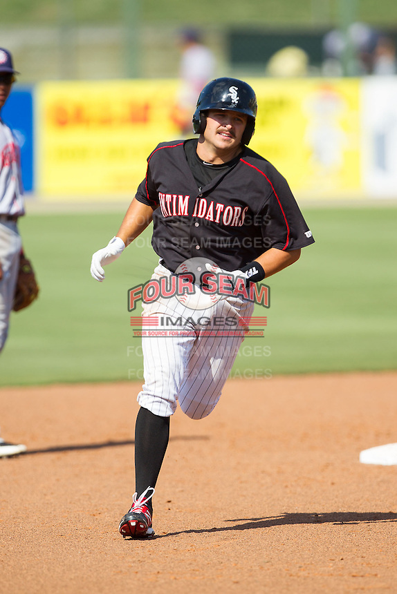 Christian Stringer (40) rounds the bases after hitting a home run against the Hagerstown Suns at CMC-Northeast Stadium on June 1, 2014 in Kannapolis, North Carolina.  The Intimidators defeated the Suns 5-1 in game one of a double-header.  (Brian Westerholt/Four Seam Images)