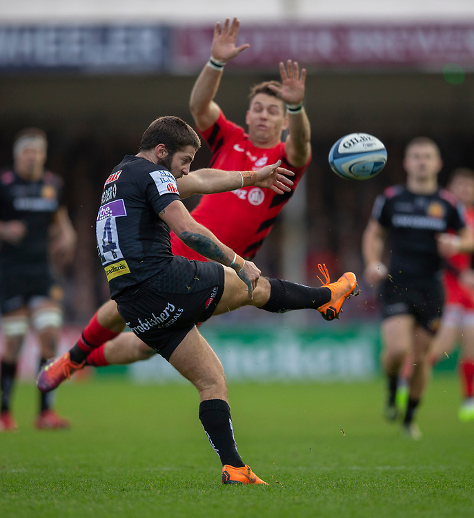 Exeter Chiefs' Santiago Cordero is almost charged down by Saracens' Alex Lewington<br /> <br /> Photographer Bob Bradford/CameraSport<br /> <br /> Gallagher Premiership Round 10 - Exeter Chiefs v Saracens - Saturday 22nd December 2018 - Sandy Park - Exeter<br /> <br /> World Copyright © 2018 CameraSport. All rights reserved. 43 Linden Ave. Countesthorpe. Leicester. England. LE8 5PG - Tel: +44 (0) 116 277 4147 - admin@camerasport.com - www.camerasport.com