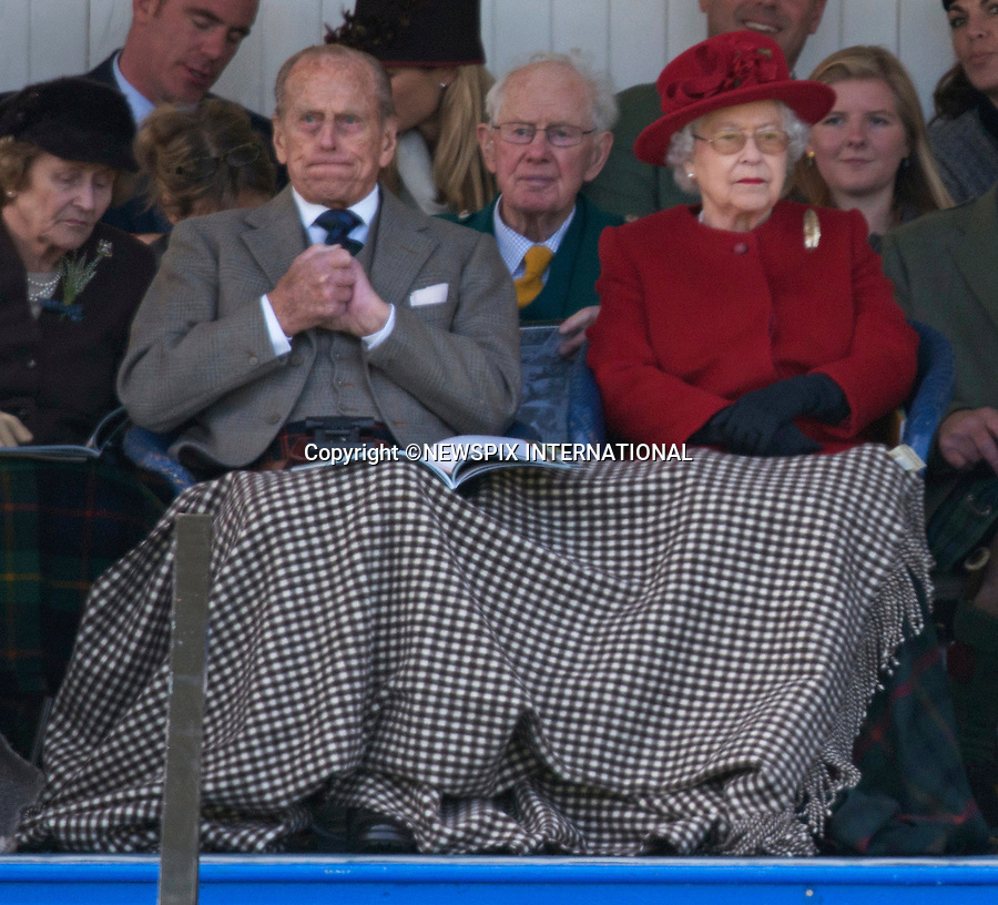 05.09.2015; Braemar, Scotland: QUEEN WINS BLANKET TUSSLE<br />Having acquired a blanket to protect her husband Prince Philip from the cold Scottish air, Queen Elizabeth did not appear to approve of him sharing it with the woman next to him to whom it looked like he was flirting.<br />She discreetly kicked off the blanket she had and pulled over the blanket that Prince Philip was sharing. <br />His expressing appears to show his displeasure, however they soon put on a united front.<br />The Royals who included The Queen, Duke of Edinburgh, Prince Charles, Peter Philips and wife Autumn were attending the 200th Braemar Highland Gathering.<br />Mandatory Photo Credit: &copy;NEWSPIX INTERNATIONAL<br /><br />**ALL FEES PAYABLE TO: &quot;NEWSPIX INTERNATIONAL&quot;**<br /><br />PHOTO CREDIT MANDATORY!!: NEWSPIX INTERNATIONAL(Failure to credit will incur a surcharge of 100% of reproduction fees)<br /><br />IMMEDIATE CONFIRMATION OF USAGE REQUIRED:<br />Newspix International, 31 Chinnery Hill, Bishop's Stortford, ENGLAND CM23 3PS<br />Tel:+441279 324672  ; Fax: +441279656877<br />Mobile:  0777568 1153<br />e-mail: info@newspixinternational.co.uk
