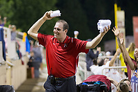 Kannapolis Intimidators Director of Communications Josh Feldman gets the crowd fired up for free t-shirts between innings of the game against the Delmarva Shorebirds at Kannapolis Intimidators Stadium on July 3, 2017 in Kannapolis, North Carolina.  The Shorebirds defeated the Intimidators 5-2.  (Brian Westerholt/Four Seam Images)