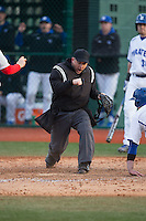 Home plate umpire Nathan Hamlett calls out Zack Weigel (not pictured) of the Seton Hall Pirates during the game against the Cornell Big Red at The Ripken Experience on February 27, 2015 in Myrtle Beach, South Carolina.  The Pirates defeated the Big Red 3-0.  (Brian Westerholt/Four Seam Images)