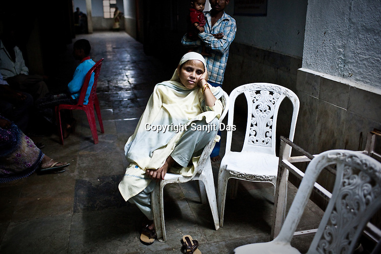 Zubeida, the grand mother of the 9 year old Tarannum Sheikh Rayees waits outside the operation theatre at the local hospital in Chalisgaon, Maharashtra, India. Rotary Club organises a free medical camp for the poor and needy. India's leading Micro and plastic surgeons visit the medical camp and provide free medical service.