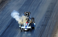Mar. 8, 2008; Bakersfield, CA, USA; Oil comes out of the engine of nostalgia top fuel dragster driver Mike McLennan prior to exploding an engine during qualifying for the 50th annual March Meet at the Auto Club Famoso Raceway. Mandatory Credit: Mark J. Rebilas-US PRESSWIRE