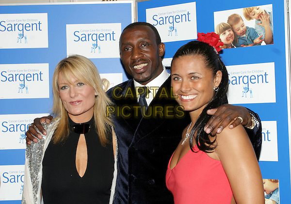 AGBBY ROSLIN, LINFORD CHRISTIE & TROY TITUS ADAMS.The Chocolate Ball in aid of sargent Cancer Care for Children at the Cafe Royal, Picadilly.11 March 2004.headshot, portrait.www.capitalpictures.com.sales@capitalpictures.com.©Capital Pictures