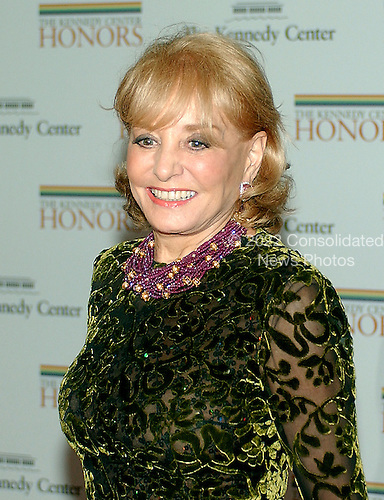 Washington, D.C. - December 2, 2006 -- Barbara Walters arrives for the State Department Dinner for the 29th Kennedy Center Honors dinner at the Department of State in Washington, D.C. on Saturday evening, December 2, 2006.  Andrew Lloyd Webber, Zubin Mehta, Dolly Parton, Smokey Robinson and Stephen Spielberg are being honored in 2006 for their contribution to American culture..Credit: Ron Sachs / CNP