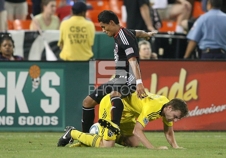 Andy Najar #14 of D.C. United takes the ball from Eddie Gaven #12 of the Columbus Crew during a US Open Cup semi final match at RFK Stadium on September 1 2010, in Washington DC. Columbus won 2-1 aet.