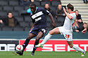 Bondz N'Gala of Stevenage clears from Scott Allan of Milton Keynes. MK Dons v Stevenage - npower League 1 - Stadium MK,  Milton Keynes - 20th October, 2012. © Kevin Coleman 2012
