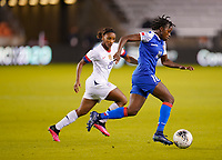 HOUSTON, TX - JANUARY 28: Nerilia Mondesir #10 of Haiti runs with the ball past Crystal Dunn #19 of the United States during a game between Haiti and USWNT at BBVA Stadium on January 28, 2020 in Houston, Texas.