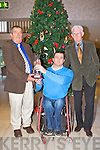 AWARD: The chairperson of the Kerry Association of Spina Bifida and Hydrocephalus Roy Guerin presenting Peter Hanley, Kenmare an award in appreciation of his service and dedication to the Kerry Association of Spina Bifida and Hydrocephalus at the Earl of Desmond hotel on Sunday l-r: Peter Hanley, Roy Guerin (chairperson) and Don O'Donghue (vice chairperson).