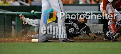 16 August 2008: Colorado Rockies' catcher Yorvit Torrealba slides home safely in the 9th inning against the Washington Nationals at Nationals Park in Washington, DC.  The Rockies defeated the Nationals 13-6, handing the last place Nationals their 9th consecutive loss. ..Mandatory Photo Credit: Ed Wolfstein Photo