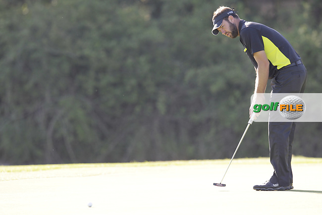 Scott Jamieson (SCO) putts on the 3rd green during Friday's Round 2 of the 2014 Open de Espana held at the PGA Catalunya Resort, Girona, Spain. Wednesday 16th May 2014.<br /> Picture: Eoin Clarke www.golffile.ie