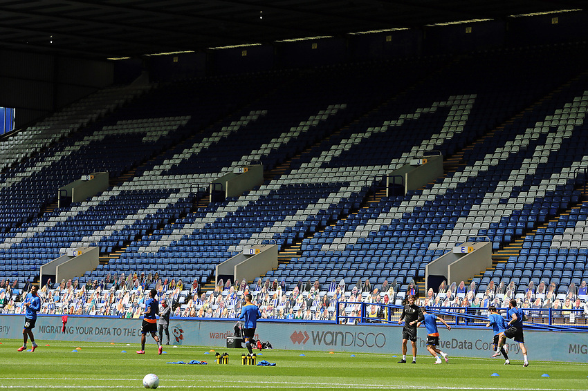 Sheffield Wednesday players go through their pre-match warm-ups in front of cardboard cut-outs replacing real fans in the stands <br /> <br /> Photographer Rich Linley/CameraSport<br /> <br /> The EFL Sky Bet Championship - Sheffield Wednesday v Nottingham Forest - Saturday 20th June 2020 - Hillsborough - Sheffield <br /> <br /> World Copyright © 2020 CameraSport. All rights reserved. 43 Linden Ave. Countesthorpe. Leicester. England. LE8 5PG - Tel: +44 (0) 116 277 4147 - admin@camerasport.com - www.camerasport.com