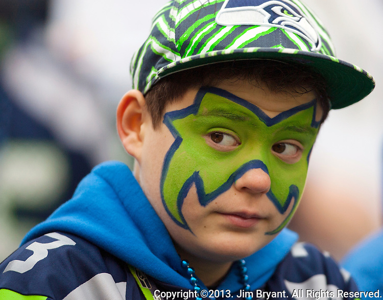Seattle Seahawks  fan Scottie Waterfield watches the Seahawks during warmups before their  game against the St. Louis Rams at CenturyLink Field in Seattle, Washington on December 29, 2013.  Seahawks clinched the NFC West title and home-field advantage throughout the playoffs with a 27-9 victory over the St. Louis Rams.    ©2013. Jim Bryant Photo. ALL RIGHTS RESERVED.