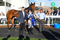 Connections of Raincall in the Winners enclosure after winning The Sharp's Doom Bar Handicap during Evening Racing at Salisbury Racecourse on 25th May 2019