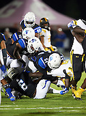 IMG Academy Ascenders Taron Vincent (54), Jordan Anthony (4), Dylan Moses (6), Grant Delpit (10) and Joshua Kaindoh (99) gang tackle Osman Savage (23) during a game against the St. Frances Academy Panthers on November 12, 2016 at IMG Academy in Bradenton, Florida.  IMG defeated St. Frances 38-0.  (Mike Janes Photography)