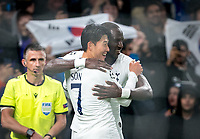 Son Heung-Min celebrates scoring the opening goal with Moussa Sissoko of Spurs during the UEFA Champions League group match between Tottenham Hotspur and Bayern Munich at Wembley Stadium, London, England on 1 October 2019. Photo by Andy Rowland.