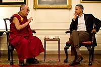 President Barack Obama meets with His Holiness the XIV Dalai Lama in the Map Room of the White House, Saturday, July 16, 2011.<br /> (Official White House Photo by Pete Souza)