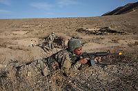 An instructor shout at his students of the Afghan National Army (ANA) who are doing an exercise that consist on gaining field on the enemy, Kabul, Afghanistan, 6th November 2017.<br /> <br /> Un instructeur crie sur ses étudiants de l'Armée nationale afghane (ANA) en plein exercice qui consiste à gagner un terrain sur l'ennemi, à Kaboul, en Afghanistan, le 6 novembre 2017.