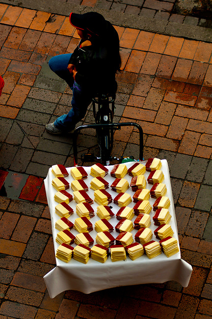 Street vendor selling bocadillo con queso de guayaba, a kind of desert with cheese, on the streets of Bogota.