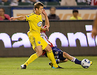 Chivas USA midfielder Ben Zemanski (21) steals the ball away from Columbus Crew midfielder Robbie Rogers (18). CD Chivas USA defeated the Columbus Crew 3-1 at Home Depot Center stadium in Carson, California on Saturday July 31, 2010.
