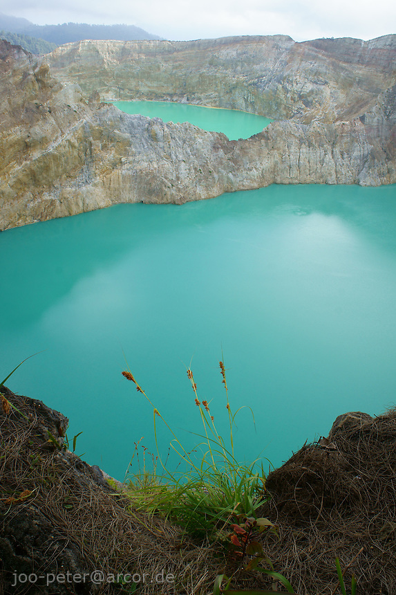 blue and green lake, Tiwu Nua Muri Kooh Tai (lake of boys and girls) and  Tiwu Ata Polo (enchanted lake),vulcano Kelimutu, island  Flores in archipelago of Indonesia. Locals in village Moni believe, the souls of passed village members  go into the lake. Changing colors of the lakes (caused by minerals) would signify, these souls are angry.