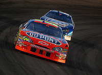 Apr 22, 2006; Phoenix, AZ, USA; Nascar Nextel Cup driver Jeff Gordon of the (24) DuPont Chevrolet Monte Carlo leads Kurt Busch during the Subway Fresh 500 at Phoenix International Raceway. Mandatory Credit: Mark J. Rebilas-US PRESSWIRE Copyright © 2006 Mark J. Rebilas..