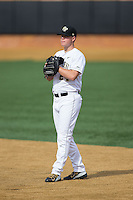 Wake Forest Demon Deacons first baseman Gavin Sheets (24) on defense against the Miami Hurricanes at Wake Forest Baseball Park on March 21, 2015 in Winston-Salem, North Carolina.  The Hurricanes defeated the Demon Deacons 12-7.  (Brian Westerholt/Four Seam Images)