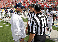 California head coach Jeff Tedford talks with the referees before the game against Ohio State at Ohio Stadium in Columbus, Ohio on September 15th, 2012.   Ohio State Buckeyes defeated California Bears, 35-28.