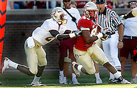 TALLAHASSEE, FLA. 4/16/11-FSUG&G041611 CH-Garnet's Ja'Baris Little is stopped by Gold's Avis Commack during second half action in the Florida State University Garnet and Gold game Saturday in Tallahassee. Garnet beat Gold 19-17..COLIN HACKLEY PHOTO