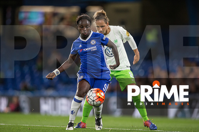 Eniola Aluko of Chelsea Ladies holds off Babett Peter of VfL Wolfsburg (women) during the UEFA Women's Champions League match between Chelsea Ladies and VfL Wolfsburg at Stamford Bridge, London, England on 5 October 2016. Photo by Andy Rowland.