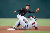 Max Dutto (6) of the Kannapolis Intimidators reaches for a throw as Leody Taveras (3) of the Hickory Crawdads slides into second with a stolen base at Kannapolis Intimidators Stadium on April 22, 2017 in Kannapolis, North Carolina.  The Intimidators defeated the Crawdads 10-9 in 12 innings.  (Brian Westerholt/Four Seam Images)