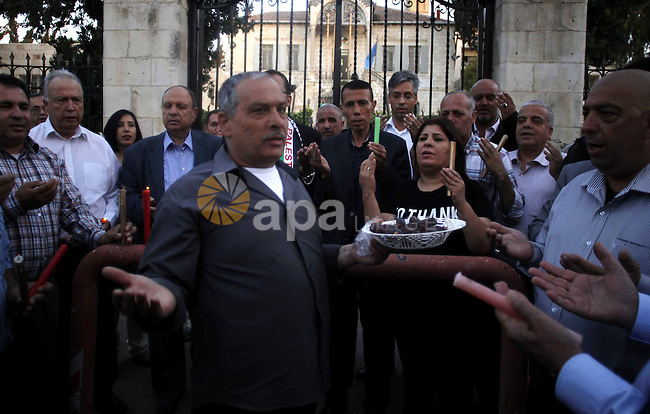 Palestinians take part in a memorial ceremony marking the 14th anniversary of the death of Faisal al-Husseini, Palestinian Authority's representative for Jerusalem affairs, outside the Orient House, which used to be the Palestinian Liberation Organisation's (PLO) unofficial headquarters, on May 31, 2015. The participants called to reopen the east Jerusalem complex, closed by Israel since 2001. Photo by Saeb Awad