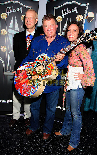 GIBSON CEO HENRY JUSZKIEWICZ, WILLIAM SHATNER  & MANDY LAWSON .at the special award/painted guitar presentation to William Shatner by Gibson Guitars at the Nashville Film Festival debut of Gonzo Ballet with a musical score composed by William Shatner (Star Trek, Boston Legal) and Ben Folds (Ben Folds Five)..Nashville, TN, USA, .April 17th 2009..full length guitar music blue shirt jeans .CAP/ADM/DH.©Dan Harr/AdMedia/Capital Pictures