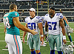 Miami Dolphins defensive tackle Jared Odrick (98), Dallas Cowboys linebacker Sean Lee (50) and Dallas Cowboys linebacker Victor Butler (57) in action during the pre- season game between the Miami Dolphins and the Dallas Cowboys at the Cowboys Stadium in Arlington, Texas. Dallas defeats Miami 30 to 13...