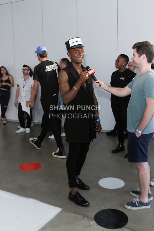 Fashion designer Julian Woodhouse being interviewed during his Wood House Spring Summer 2018 collection presentation, for New York Mens Day at Dune Studios on July 10, 2017; duing New York Fashion Week: Mens Spring Summer 2018.