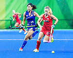 Katie Bam #16 of United States carries the ball pup the field during USA vs Japan in a Pool B game at the Rio 2016 Olympics at the Olympic Hockey Centre in Rio de Janeiro, Brazil.