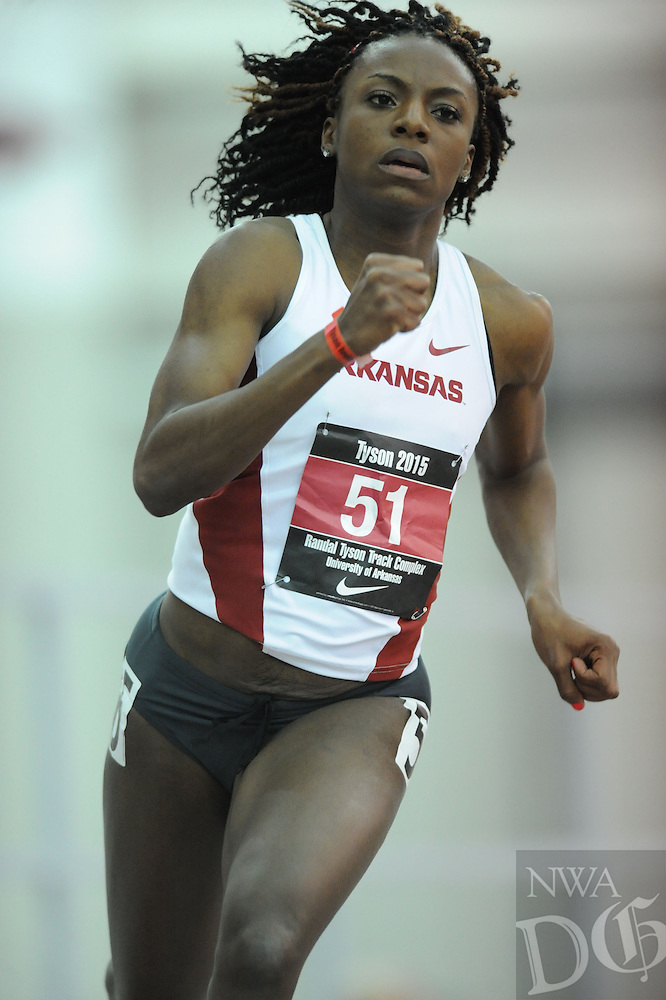 NWA Democrat-Gazette/ANDY SHUPE - Sparkle McKnight of Arkansas rounds the final turn while competing in the 400 meters during the Tyson Invitational Friday, Feb. 13, 2015, at the Randal Tyson Track Center in Fayetteville.