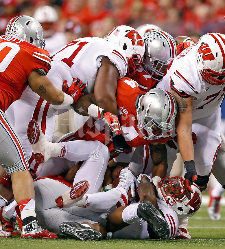 Ohio State Buckeyes linebacker Curtis Grant (14) against Wisconsin Badgers in the 2014 Big Ten Football Championship Game at Lucas Oil Stadium in Indianapolis, Ind. on December 6, 2014.  (Dispatch photo by Kyle Robertson)