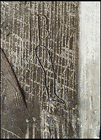 BNPS.co.uk (01202 558833)<br /> Pic: PhilYeomans/BNPS<br /> <br /> A damaged limb (here a leg) would be drawn to aid its recovery.<br /> <br /> Salisbury Cathedral has taken the unusual step of launching 'Grafitti Tours' of it's 800 year old building, as part of a three year project to document the thousands of examples of centuries-old 'graffiti' which adorn the walls of the 13th century cathedral.<br /> <br /> The inside of the Cathedral in Wiltshire is covered in markings etched into its fabric by fervent, desperate or just bored visitors ranging from simple inscriptions to more intricate designs used to ward off evil spirits.  <br /> <br /> Cathedral guide Steve Dunn intends to record all the marks or 'graffiti' which in some cases date back from when the cathedral was completed in 1258.<br /> <br /> Helped by about 60 volunteers, he is collating images of the graffiti and researching the story behind them.<br /> <br /> There are so-called Hexfoil or witches' marks - compass drawn circles with propeller like shapes inside them - which were designed to 'catch' demons.<br /> <br /> It was believed that the demons' curiosity and stupidity would lead them to enter the circles where they would be trapped and forced to be preached at forever.