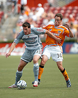 FC Dallas forward Kenny Cooper (33) attempts to hold the ball from Houston Dynamo midfielder Richard Mulrooney (30).  Houston Dynamo beat FC Dallas 2-1 at Robertson Stadium in Houston, TX on June 3, 2007.