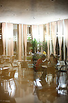 ©2008 David Burnett / Contact Press Images..July 12 2008..Havana, Cuba.Interiors at Riviera Hotel, Vedado©2008 David Burnett / Contact Press Images..July 12 2008..Havana, Cuba.Large crowds gather for Summer in Havana outdoors music..TIME writer Nathan Thornburgh with former musician friend Hanry Suarez , at dinner: Havana