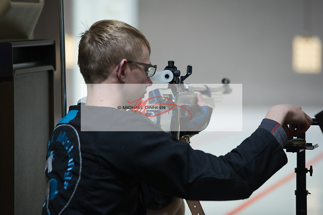Chugiak's Keaton Torgerson warms up st the at the Chugiak vs. Eagle River riflery match Friday, Oct. 21, 2016.  Photo for the Star by Michael Dinneen