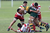 Three Karaka defenders finally stop Cameron Skeltons run. Counties Manukau Premier Counties Power Club Rugby game between Karaka and Pukekohe, played at the Karaka Sports Park on Saturday March 10th 2018. Pukekohe won the game 31 - 27 after trailing 5 - 20 at halftime.<br /> Photo by Richard Spranger.