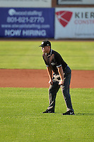 Base umpire Jordan Johnson during the game against the Great Falls Voyagers and the Ogden Raptors on July 17, 2014 at Lindquist Field in Ogden, Utah. (Stephen Smith/Four Seam Images)